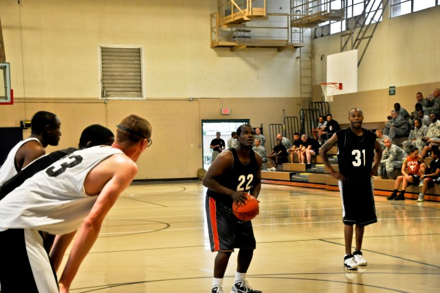 "FORT CAMPBELL, KY "" Spc Antione McNeil with 2nd Brigade Combat Team, 101st Airborne Division (Air Assault), takes his first free-throw shot after being fouled by the opposing team, Aug. 13, at Fort Campbell's Lozada Gym. McNeil has been playing basketball since he can remember and his team considers him an important asset to the Strike team."