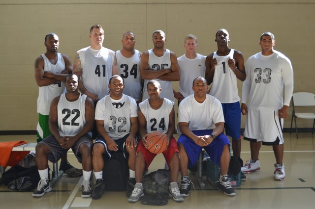 "FORT CAMPBELL, KY "" The soldiers of 2nd Brigade Combat Team, 101st Airborne Division (Air Assault), that make up the Strike Brigade's Week of the Eagles basketball team, pose for a team photo prior to the championship game against 3rd Battalion, 5th Special Forces Group on Aug. 15. The basketball competition was held at Fort Campbell's Lozada Gym. The Strike Brigade team put forth their best effort and ended up with a silver medal for second place."