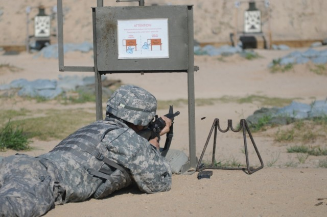 """CAMP CARROLL, South Korea""""A Soldier assigned to the 501st Sustainment Brigade, qualifies sharpshooter, during the Champion M9/M16 Range held at the Carroll rifle range on Camp Carroll, August 3, 2012. (U.S. photo by Army Staff Sgt. Robert DeDeaux 501st SBDE Public Affairs)"""