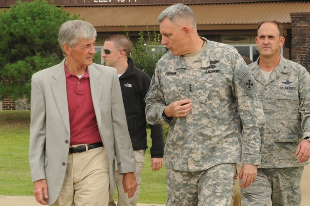 Secretary of the Army John McHugh (left) talks with Eighth Army Commanding General Lt. Gen. John D. Johnson at Osan Air Base, South Korea, Aug. 16, 2012.