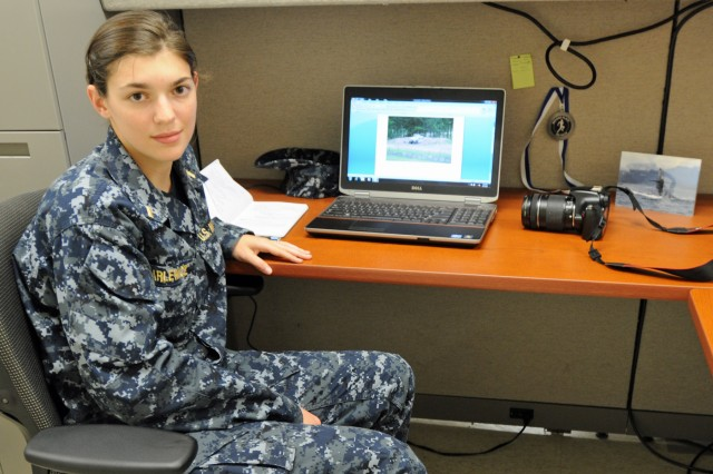 Ensign Lauren Karlewicz, a unit public affairs representative with  6th Sqdrn., 8th Cav. Regt., 4IBCT, 3rd ID, sits at her desk to complete a news story, Aug. 7, at Fort Stewart, Ga.