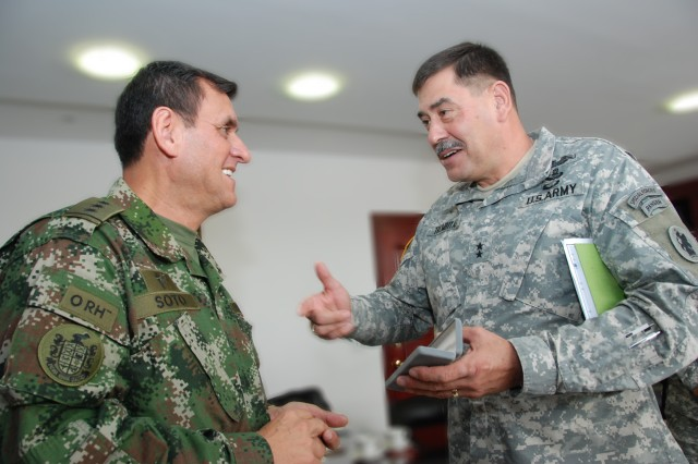 Maj. Gen. Simeon G. Trombitas (right), U.S. Army South commanding general, visits with Maj. Gen. Pedro L. Soto, the Colombian army inspector general, Aug. 2, 2012, in Bogata, Columbia.