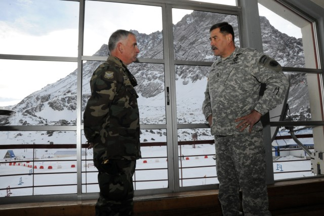 Maj. Gen. Simeon G. Trombitas (right), the U.S. Army South commanding general, talks with Chilean Col. Jorge Lecanda Ricalde, the commander of the Chilean Escuela de Montana (Mountain School), upon his visit to the school in the Andes Mountains, Aug. 7, 2012, in Portillo, Chile.
