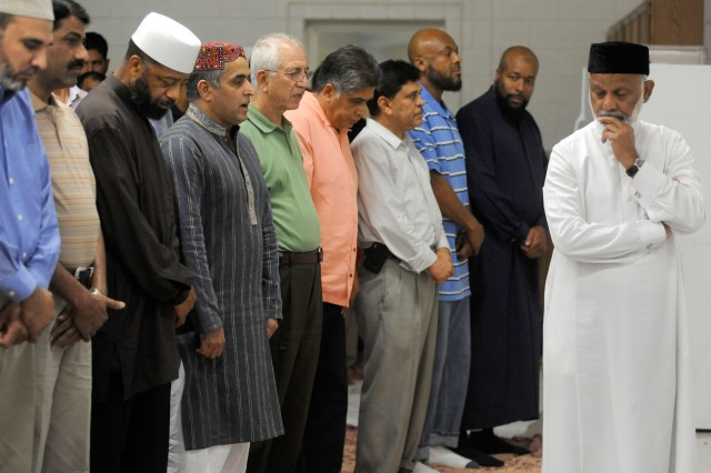 (Right) Imam Fazul Khan of the Islamic Society of the Washington Area prepares to lead the Maghrib before the fast break on Friday night. The Maghrib is prayed just after sunset and is the fourth of five obligatory prayers Muslims must make every day.