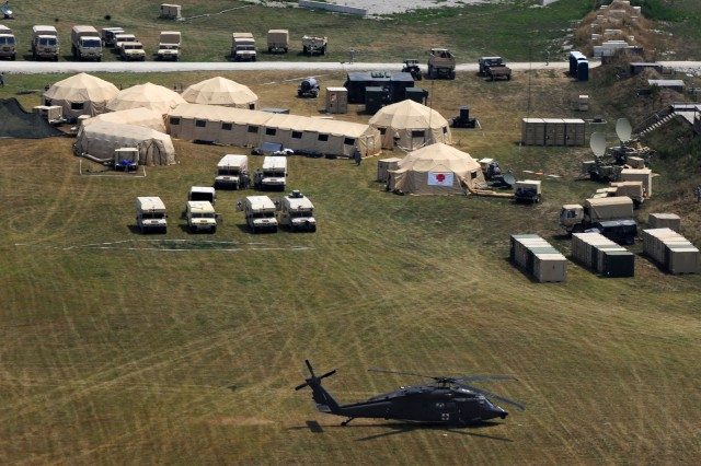 The Defense Chemical, Biological, Radiological and Nuclear Response Force, or DCRF, participates in Exercise Vibrant Response 13 at Camp Atterbury, Ind., July 31, 2012. Exercise Vibrant Response is a training event for the DCRF. The exercise focuses on Department of Defense support of civil authorities in a in a consequence management role. The DCRF is part of DOD's scalable response capability to assist civilian responders in saving lives, relieving human suffering and provide critical support to enable support to enable community recovery following a catastrophic chemical, biological, radiological, and nuclear incident.