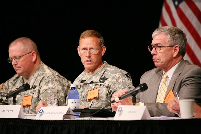 Brig. Gen. Timothy R. Coffin, deputy commanding general for operations, U.S. Army Space and Missile Defense Command/Army Forces Strategic Command, introduces himself during the Space Panel, Aug. 15, 2012, at the Von Braun Center in Huntsville, Ala., during the 15th annual Space and Missile Defense Conference.