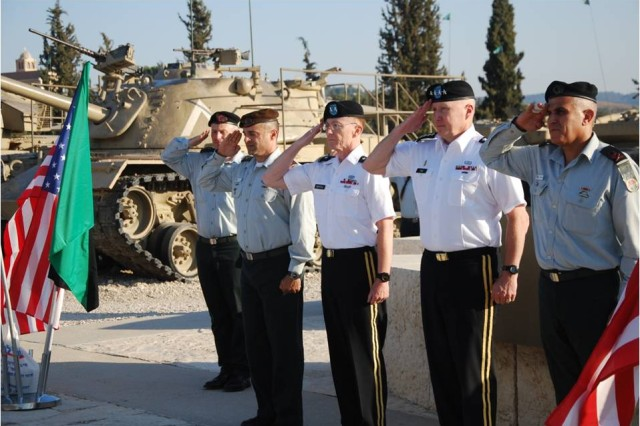 LATRUN -- Gen. Robert W. Cone, commanding general of U.S. Army Training and Doctrine Command, and Maj. Gen. Shlomo Turgeman (to Cone's left), chief of IDF Ground Forces, participate in an honor guard and wreath-laying ceremony at Latrun Armor Museum July 15, 2012. Maj. Gen. Art Bartell (to Cone's right) and Brig. Gen. Oren Avman, deputy heads of delegation, also participated in the ceremony. (Courtesy photo)