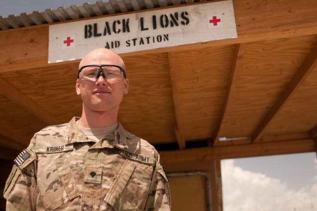 "PAKTIKA PROVINCE, Afghanistan "" Spc. Ryan Kriner poses for a picture under the Black Lions Aid station entrance. Kriner is a combat medic, for the 1st Battalion, 28th Infantry Regiment, 4th Infantry Brigade Combat Team, 1st Infantry Division.  (U.S. Army photos by Sgt. Gene Arnold, Task Force 4-1 PAO)"