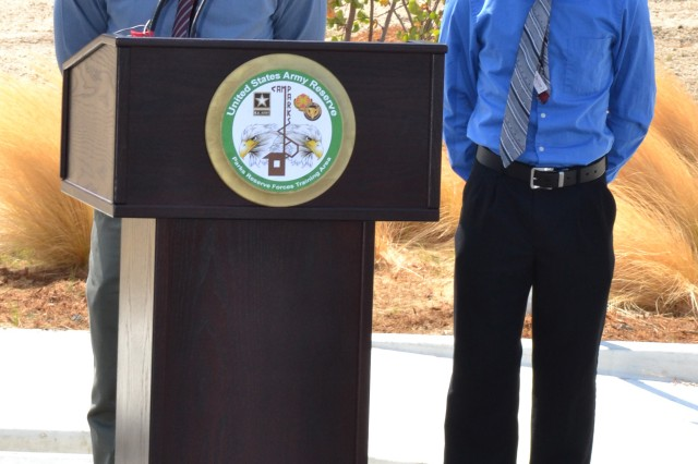 Xariel and Micah Hernandez address the audience at the building dedication and ribbon cutting ceremony for their farther Staff Sgt. Robert Hernandez at Camp Parks Calif., August 17, 2012.