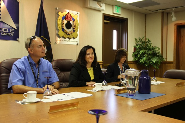 Katherine Hammack receives a command brief overview on the vision, mission and accomplishments of the 70 year old Tooele Army Depot which provides readiness and rapid munitions response to America's allies and war fighters worldwide.