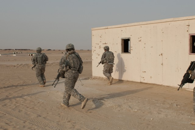 Soldiers of A Company, 4th Battalion, 118th Infantry Regiment jog to their next objective during a platoon live-fire exercise at the Udairi Range Complex in northern Kuwait, July 31, 2012. The Soldiers cleared buildings and a trench complex during the exercise. In addition to undertaking camp and security-force operations, the South Carolina Army National Guard Soldiers have kept up the pace of their training since deploying to Kuwait in April.