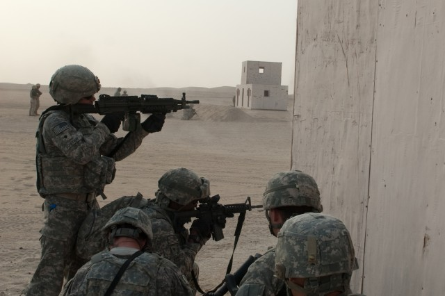 Soldiers of Company A, 4th Battalion, 118th Infantry Regiment engage targets during a platoon live-fire exercise at the Udairi Range Complex in northern Kuwait, July 31, 2012. The Soldiers also cleared buildings and a trench system during the exercise. In addition to undertaking camp and security-force operations, the South Carolina Army National Guard Soldiers have kept up the pace of their training since deploying to Kuwait in April.