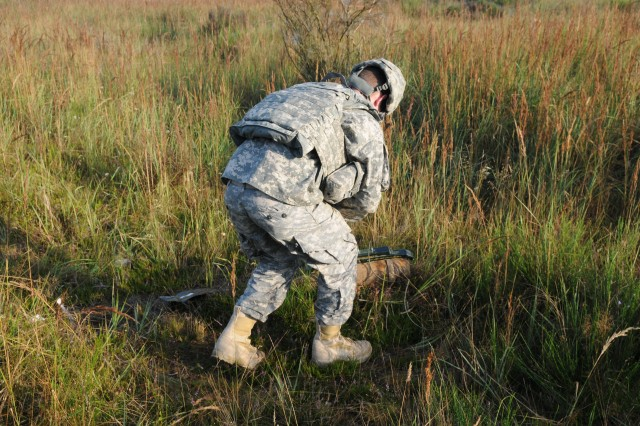 A soldier with the 387th EOD preps unexploded ordnance, also known as UXO, on a firing range.  Once the charges are primed and ready, EOD will detonate the explosives that will dispose of the UXO.  The 387th EOD is currently conducting real-world EOD, as part of the Overseas Deployment Training program at the Joint Multinational Training Command, also known as JMTC, at Grafenwoehr, Germany.   The JMTC is the U.S. Army's only overseas training command. (U.S. Army Photo by Staff Sgt. Christopher Bryant, 340th PAD)