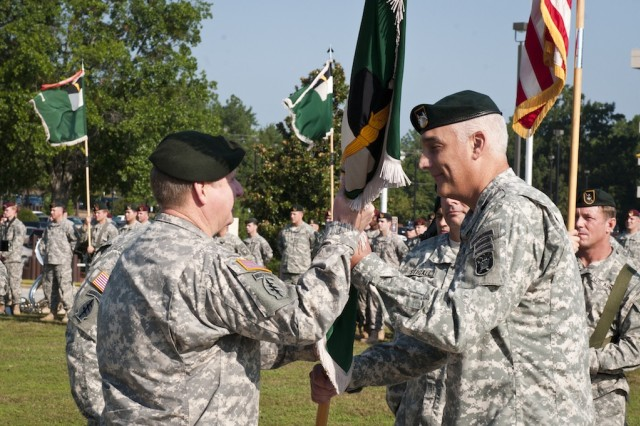 Maj. Gen. Bennet S. Sacolick (right) passes the U.S. Army John F. Kennedy Special Warfare Center and School colors to Lt. Gen. Charles T. Cleveland, commander of the U.S. Army Special Operations Command, during a SWCS change of command ceremony Aug. 16 on Fort Bragg. Sacolick's next assignment will be with the U.S. Special Operations Command in Tampa, Fla. (U.S. Army photo by Dave Chace, SWCS Public Affairs Office)