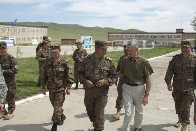 Secretary of the Army John McHugh walks with Maj. Gen. B. Bayarmagnai, deputy chief of general staff, Mongolian Armed Forces, during a visit to observe Khaan Quest 2012 held at the Mongolian Armed Forces Peace Support Center in the vicinity of Ulaanbaatar, Mongolia, Aug. 15, 2012. Khaan Quest is regularly scheduled multinational exercise sponsored by U.S. Army Pacific and hosted annually by the Mongolian Armed Forces. (U.S. Army photo by Spc. John G. Martinez)