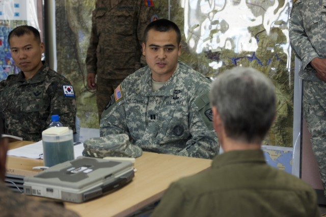 Secretary of the Army John McHugh speaks with Capt. Walter Hotch-Hill, logistics officer, 1-297th Reconnaissance and Surveillance Squadron,  Alaska Army National Guard, during a visit during exercise Khaan Quest 2012, Aug. 15, held at the Mongolian Armed Forces Peace Support Center in the vicinity of Ulaanbaatar, Mongolia, Aug. 15, 2012. Khaan Quest is regularly scheduled multinational exercise sponsored by U.S. Army Pacific and hosted annually by the Mongolian Armed Forces. (U.S. Army photo by Spc. John G. Martinez)