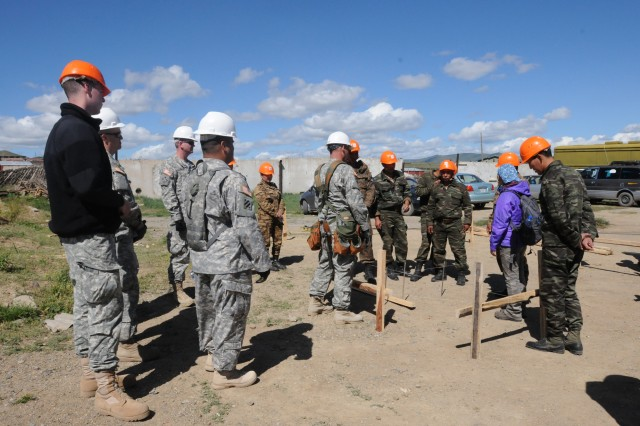 Sgt. Charles Nash, 6th Engineer Battalion, conducts a site layout demonstration during a multinational Engineer Subject Matter Expert Exchange held at Nalaikh district, Mongolia, Aug. 17, 2012. Mongolian, U.S. service members and Canadian Forces participated in three days of classroom instruction and then moved to a Mongolian Armed Forces camp for project oversight.
