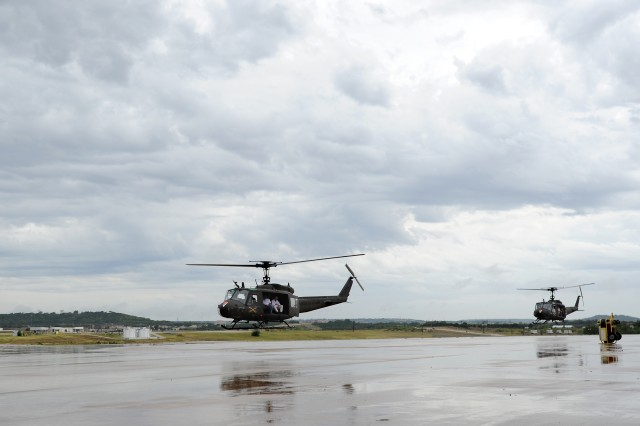 "UH-1 helicopters, operated by the 21st Cavalry Brigade (Air Combat), carry Vietnam veterans back to Robert Gray Army Airfield after an airlift during a farewell and retirement ceremony for three UH-1 ""Huey"" helicopters at Fort Hood, Texas, Aug. 18, 2012."