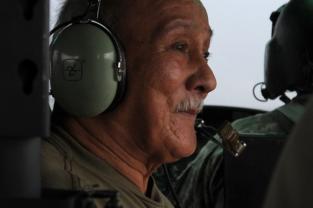"Vietnam veteran Tony Blas, who served with Company B, 1st ""Garryowen"" Squadron, 7th Cavalry Regiment, 1st Cavalry Division in Vietnam from 1968-1972, rides on board a Huey as part of the farewell and retirement ceremony for three UH-1 ""Huey"" helicopters at Fort Hood, Texas, Aug. 18, 2012."