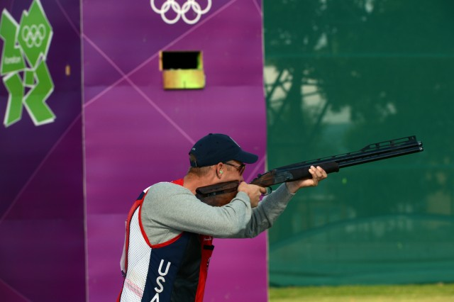 U.S. Army World Class Athlete Program shotgun shooter Sgt. Glenn Eller shoots the opening round of Olympic men's double trap qualification at the Royal Artillery Barracks range in London. Eller, the defending Olympic gold medalist, had two double misses in the first round that likely dropped him from medal contention.