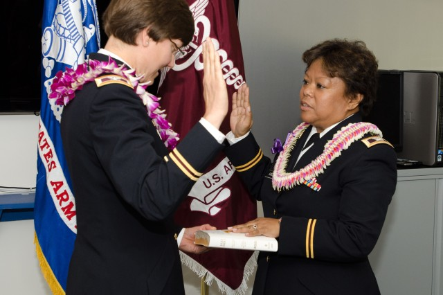 Col. Theresa M. Schneider, Army Medical Specialist Corps chief, administers the oath of office to Col. Myrna C. Callison. (Photo by Graham Snodgrass, USAPHC Visual Information Division)