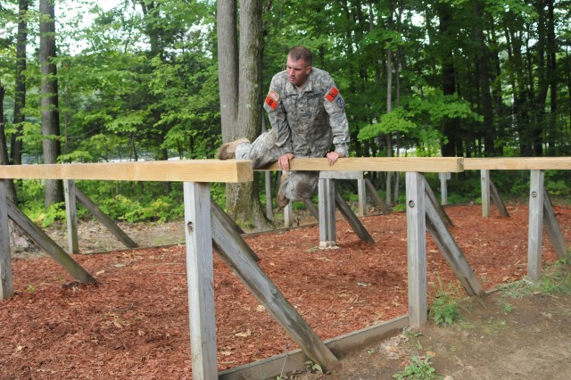 Sgt. Ryan Savoy, 210th Brigade Support Battalion, 2nd Brigade Combat Team, completes an obstacle.