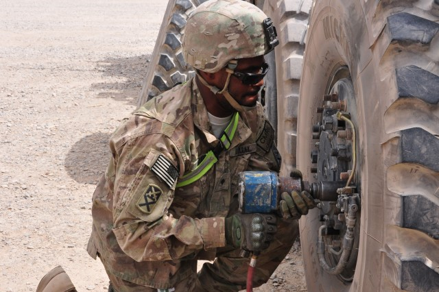 "Spc. Laashton Elliot, a truck driver with the 781st Transportation Company drills wheel nuggets during a truck rodeo on August 17, 2012 at Kandahar Airfield. The 781st TC was one of four teams competing for the right to be called ""Best Trucking Company on KAF."" (U.S. Army photo by Sgt. Gregory Williams)"
