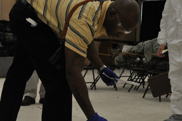 Military police collect 'evidence' following an active shooter training scenario on Fort Jackson, S.C.