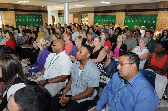 "FORT SAM HOUSTON, Texas - Fort Sam Houston Independent School District employees kick off the 2012-2013 school year Aug. 21 with an address from Lt. Gen. William Caldwell IV, commanding general, U.S. Army North, and senior commander, Fort Sam Houston and Camp Bullis. Caldwell discussed the challenges and opportunities associated with working with military children, and thanked school district employees for all they do. ""Every day you are preparing them for the future, using your own time after school and on weekends,"" said Caldwell. ""You're helping to raise our children, serving as role models and instilling values."" (U.S. Army photo by Sgt. Lee Ezzell, Army North PAO)"