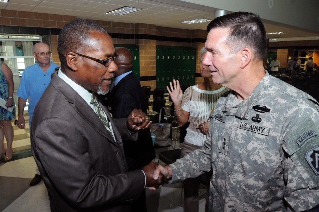 "FORT SAM HOUSTON, Texas - Eustace Lewis, a school board member of the Fort Sam Houston Independent School District, talks with Lt. Gen. William Caldwell IV, commanding general, U.S. Army North, and senior commander, Fort Sam Houston and Camp Bullis, after Caldwell's address to district employees at the back-to-school convocation Aug. 21 at the Robert G. Cole Middle School. ""The challenges you face are greater than you'd find in any other school district,"" said Caldwell to district employees during his address. ""We are incredibly appreciative of what you do for our children, and what you do will have a lasting impact."""
