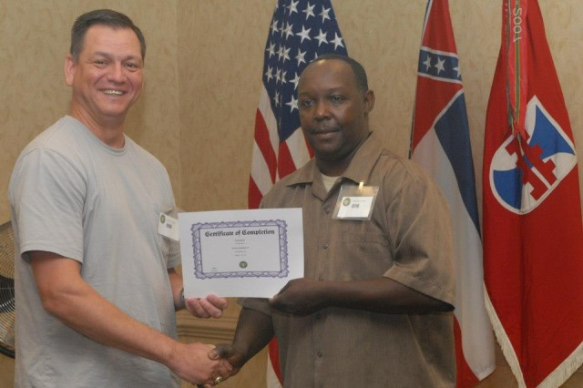 Soldier receives certificate of appreciation from Detachment 23 OIC, 412th Theater Engineer Command, during their first Yellow Ribbon event at the Jackson Hilton, Miss. DET 23 is scheduled to deploy to Afghanistan in support of Operation Enduring Freedom later this year.