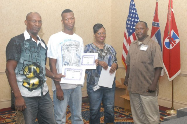 A Soldier of Detachment 23, 412th Theater Engineer Command, and Family members receive certificates of appreciation from his unit OIC during their first Yellow Ribbon event at the Jackson Hilton, Miss. DET 23 is scheduled to deploy to Afghanistan in support of Operation Enduring Freedom later this year.