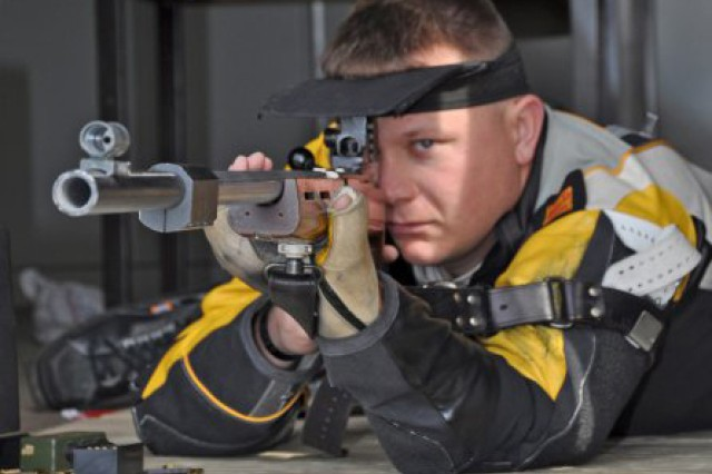 Sgt. 1st Class Joshua Olson takes aim earlier this year on his goal of competing in the Paralympic games.