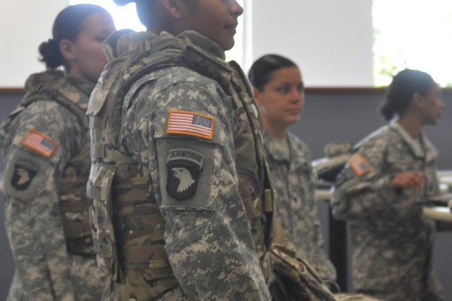 "Spc. Araceli Rojas listens to instructions regarding her newly issued Generation III Improved Outer Tactical Vest, Aug. 21, 2012, at the Personnel Processing Center at Fort Campbell, Ky. The 1st Brigade Combat Team, 101st Airborne Division (Air Assault) Soldier, who is participating in the fielding of the vests for women, said ""it fits right"" and should help Female Engagement Team members when they deploy to Afghanistan later this year."