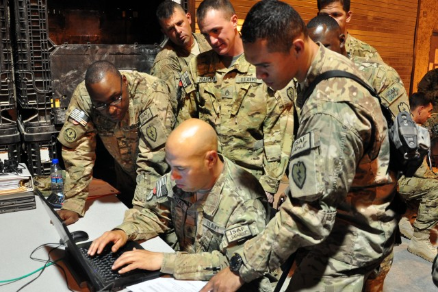 Soldiers with Task Force Hammer Head import and export containers using the Automated Air Load Planning System during a Unit Movement Officer Rodeo competition on August 15, 2012 at Kandahar Airfield. (U.S. Army photo by Sgt. Gregory Williams)