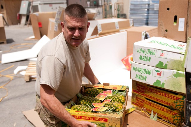 Staff Sgt. Wesley McCarty, a food service specialist with the 3d Sustainment Command (Expeditionary), unloads a shipment of fruit while working at Kandahar Airfield's Special Operations Task Force-South dining facility.  The 3d ESC worked with Kandahar Airfield's Special Operations Task Force-South to allow its cooks to work in the DFAC that they could be prepared for what they may face upon returning to Fort Knox. (U.S. Army photo by Staff Sgt. Michael Behlin)