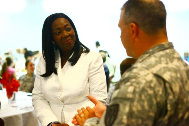 Lawton native Debra Jordan speaks with Col. Brian Dunn, Fires Center of Excellence and Fort Sill chief of staff, before the start of the installation's Women's Equality Day observance Aug. 16 at the Patriot Club. Jordan, an Army GS-15 business manager at Installation Management Command, spoke about women empowering themselves, named several people in the Lawton-Fort Sill community who influenced her life, and how she began her federal career as a GS-4 at Fort Sill.