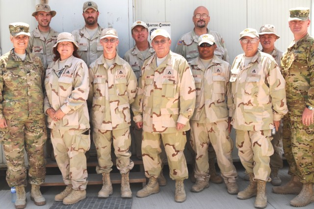Front row, from left: Col. Irene Dickerson, 401st Army Field Support Brigade deputy to the commander for support operations; Denise Batchelor, Defense Ammunition Center, McAlester, Okla.; Michael Walsh, Rock Island Arsenal, Ill.; Terry Mines, Defense Ammunition Center, McAlester, Okla.; Noberto  Cullen, Tooele Army Depot, Utah; Neil Wachutka, Joint Munitions Command senior command representative for 401st AFSB; and Chief Warrant Officer 4 David Turner, officer-in-charge of the U.S. Forces-Afghanistan J-4 Munitions Branch. Back row, from left: Brett Haddock, Letterkenny Army Depot, Pa.; Steven Buck, Tooele Army Depot, Utah; Mark Merboth, Redstone Arsenal, Ala.; Kyle Voelcker, Rock Island Arsenal, Ill.; and John Reilly, Fort Carson, Colo. Not shown are George Wilson, Crane Army Ammunition Activity, Ind., and Sgt.1st Class Robert John, 593rd Sustainment Brigade, Joint Base Lewis-McChord, Washi., currently assigned to 1st Theater Sustainment Command. (Photo by Summer Barkley, 401st AFSB Public Affairs)