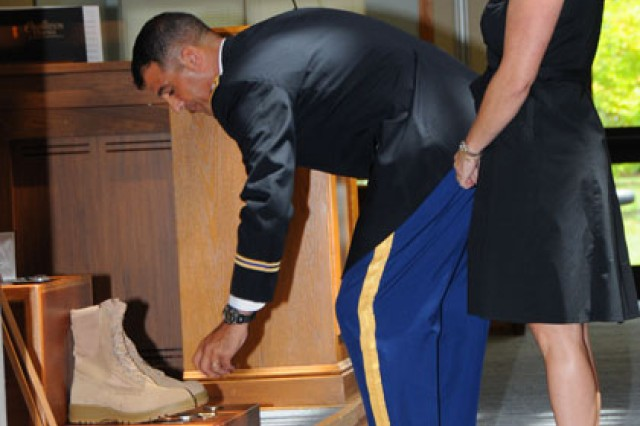 Lt. Col. Demetrios J. Nicholson, commander of the 1st Battalion, 223rd Aviation Regiment, and his wife, Christina, honor Baker at a memorial service held at the Post Chapel Aug. 17.