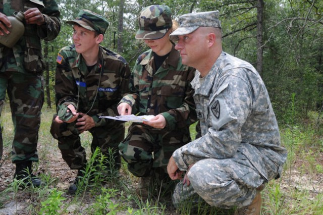Staff Sgt. Vernon McNabb, B Com., 1st Bn., 13th Avn. Regt., helps two cadets locate their next point.