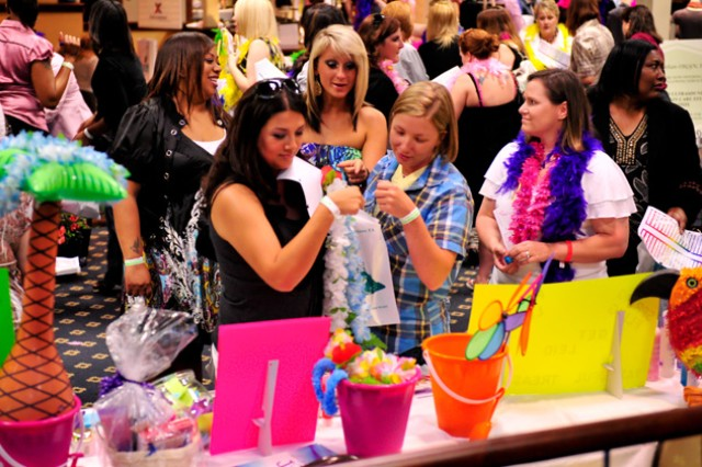 Women window shop and meet with local vendors during last year's Girls Night Out.