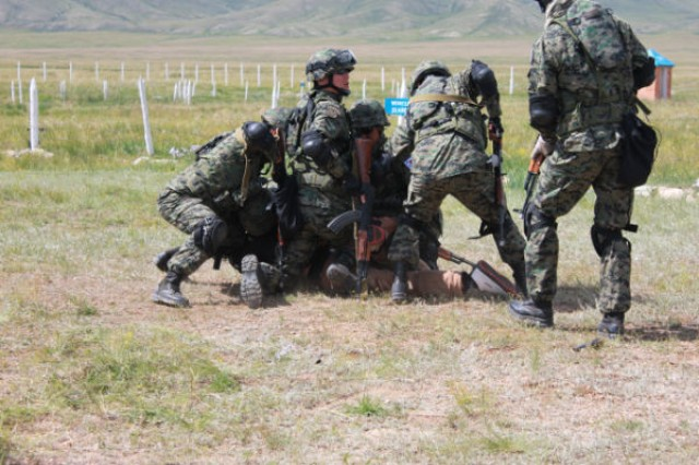 South Korean Soldiers use force to subdue an uncooperative person during a checkpoint security training event at Five Hills Training Area, Mongolia, during Khan Quest, held Aug. 11-23, 2012. The training provided the South Koreans proper tactics, techniques, and procedures while operating at a checkpoint or base entrance. Khan Quest is a U.S. Army Pacific sponsored exercise conducted annually with Mongolian Armed Forces designed to promote multinational cooperation and regional security.