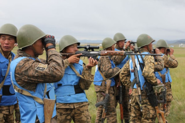 Soldiers from the Mongolian Armed Forces use various optical sights to spot inert counter improvised explosive devices, or IEDs, at Five Hills Training Area, Mongolia, during a training event at exercise Khan Quest, held Aug. 11-23, 2012. Khan Quest is a U.S. Army Pacific sponsored exercise conducted annually with the Mongolian Armed Forces designed to promote multinational cooperation and regional security.
