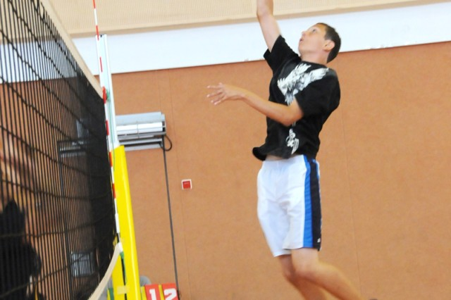 Brandon Boozer, 13, of Stuttgart, leaps high to send a spike down on his opponents, earning his team a point during a scrimmage at the A.C.E. Volleyball Camp in Vilseck, Aug. 17.