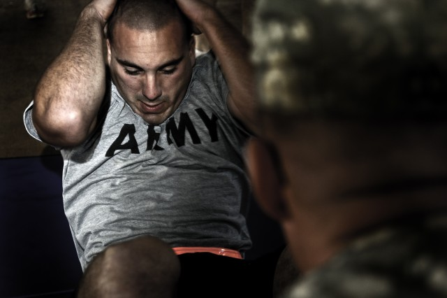 The Army will retain the current three-event Army Physical Fitness Test, pending a study to determine the best method to measure baseline Soldier physical readiness. Pictured here, a Soldier assigned to the 8th Military Police Brigade completes a situp as part of the Army Physical Fitness Test during the 8th Military Police Brigade's Best Warrior Competition at Schofield Barracks, Hawaii, April 10, 2012.