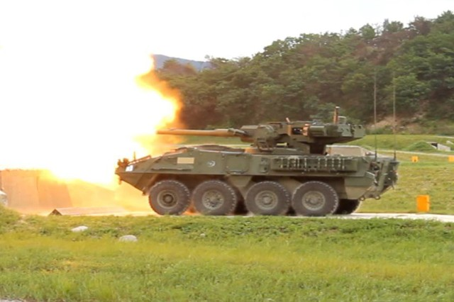 A Mobile Gun System crew from Bravo Company, 1-27th Infantry, fires a 105mm canister round downrange while in a defensive position during Ulchi Freedom Guardian 2012 in South Korea.