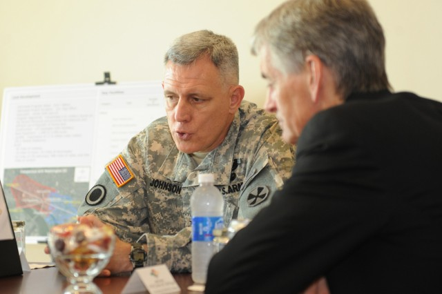Lt. Gen. John D. Johnson, commanding general of Eighth Army, discusses the planned relocation of its headquarters to Camp Humphreys, South Korea, with the Secretary of the Army John McHugh.