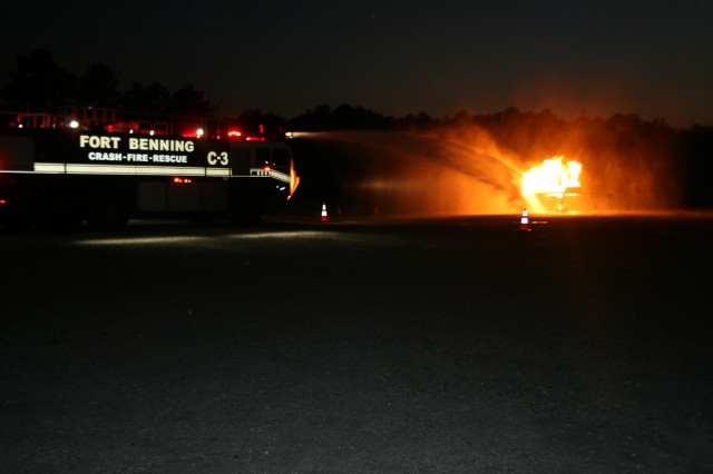 Firefighters at Fort Benning,Ga., conduct an aircraft fire exercise. The Department of Defense's Best Large and Small Fire Departments of the Year awards have been won by Fort Benning, Ga., and Fort Meade, Md., respectively.