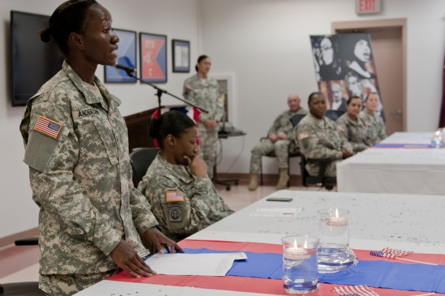 Spc. Diana Anderson, a combat medic in 3rd Brigade Special Troops Battalion, 82nd Airborne Division, and a native of Kenya, describes her long journey of overcoming racism and abuse abroad to joining the Army to care for her child during 3rd BSTB's Women's Equality Day ceremony, Aug. 25, 2012. Women's Equality is celebrated annually in commemoration of women gaining the right to vote in 1920.