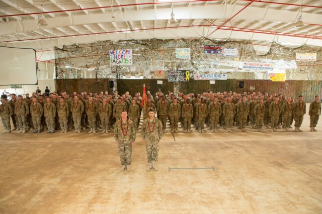The 95th Engineer Company (Clearance), 65th Eng. Battalion, 130th Eng. Brigade, 8th Theater Sustainment Command stands before their families during a redeployment ceremony Aug. 14 at Wheeler Gulch, Wheeler Army Airfield.